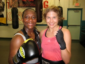 Bad News Brown after a sparring session with newcomer Canadian flyweight Amanda Beaudin.